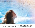 young beautiful woman under a... | Shutterstock . vector #1286782636