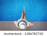 woman in a beach hat with long... | Shutterstock . vector #1286782720
