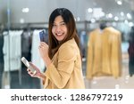 asian woman using credit card... | Shutterstock . vector #1286797219