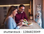 smiling couple sitting at...   Shutterstock . vector #1286823049
