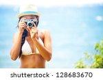 summer beach woman holding... | Shutterstock . vector #128683670