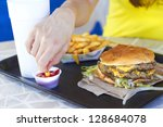 close up of female hand dipping ... | Shutterstock . vector #128684078
