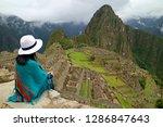 female traveler sitting on the... | Shutterstock . vector #1286847643