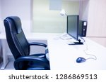 the computer is on the table in ...   Shutterstock . vector #1286869513