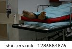 the bed dead man feet in the... | Shutterstock . vector #1286884876