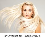 beautiful woman with long... | Shutterstock . vector #128689076