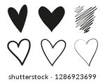 hand drawn grungy hearts on... | Shutterstock .eps vector #1286923699