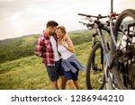 loving couple stnding next to... | Shutterstock . vector #1286944210