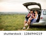 loving couple sitting in the... | Shutterstock . vector #1286944219