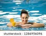 attractive smiling brunette... | Shutterstock . vector #1286956096