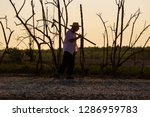 Silhouette Of Man With Hoe ...