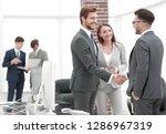 handshake business partners at... | Shutterstock . vector #1286967319