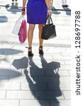 Young shopping woman crossing street - stock photo