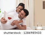 happy young couple celebrating...   Shutterstock . vector #1286985433