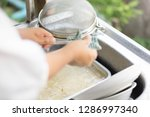 cleaning kitchenware to remove... | Shutterstock . vector #1286997340