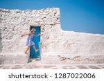 adorable girl in blue dress...   Shutterstock . vector #1287022006