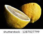 close up of a sour yellow lemon ... | Shutterstock . vector #1287027799