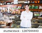 smiling female seller showing... | Shutterstock . vector #1287044443