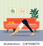 young woman in yoga dog pose in ... | Shutterstock .eps vector #1287048070