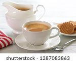 a cup of tea on white wooden... | Shutterstock . vector #1287083863