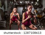 two women doing endurance while ... | Shutterstock . vector #1287108613