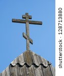 Old Wooden Cross On Roof...