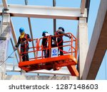 man working on the working at... | Shutterstock . vector #1287148603