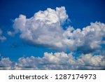white cloud on blue sky. sunny... | Shutterstock . vector #1287174973