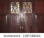 wooden doors and sunlight | Shutterstock . vector #1287188263