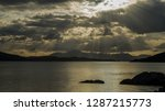 sunset with sunbeams after in... | Shutterstock . vector #1287215773