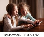 children playing on tablet.... | Shutterstock . vector #128721764
