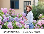 young woman is smiling in... | Shutterstock . vector #1287227506