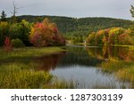 Fall colors on the Mattawa river at Mattawa island at sundown