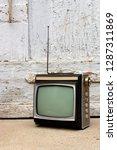 retro tv as obsolete dusty tv... | Shutterstock . vector #1287311869