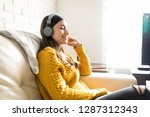 side view of content woman... | Shutterstock . vector #1287312343