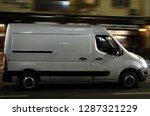 a truck rides down the street ... | Shutterstock . vector #1287321229
