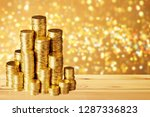golden coins stacks on ... | Shutterstock . vector #1287336823