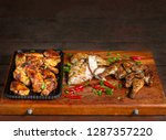 grilled chicken wings laid out... | Shutterstock . vector #1287357220