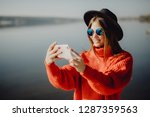 girl in the hat sitting on the... | Shutterstock . vector #1287359563