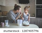 funny daughter and mother cook... | Shutterstock . vector #1287405796
