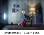 young  woman sitting on a chair ...   Shutterstock . vector #128741456