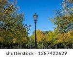 vintage lantern on pole between ... | Shutterstock . vector #1287422629