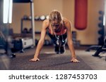 sporty woman doing push ups on...   Shutterstock . vector #1287453703