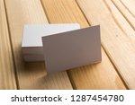 business card blank on wooden... | Shutterstock . vector #1287454780