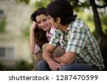 side view of a young couple... | Shutterstock . vector #1287470599