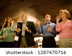 group drinking wine and smoking ... | Shutterstock . vector #1287470716