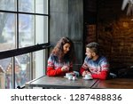 couple walking through winter... | Shutterstock . vector #1287488836
