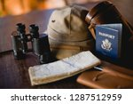 passport a long with binoculars ... | Shutterstock . vector #1287512959
