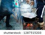 hot drinks in a pot over an... | Shutterstock . vector #1287515203