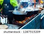 hot drinks in a pot over an... | Shutterstock . vector #1287515209